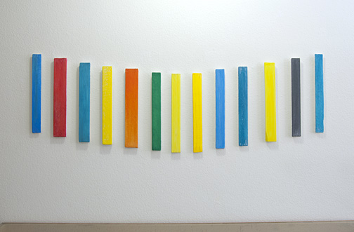Joseph Egan / Voices Nr. 12  2010  in 13 parts overall dimensions: 50 x 140 x 3 cm each part: 37 x 5 x 3 cm various paints and sand on wood