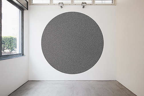 Sol LeWitt / Wall Drawing #1180  2005 10'000 straight and 10'000 not straight lines within a four-meter circle   black marker Drawn by: Nicolai Angelov, 2015 Photo by: Thomas Cugini, Zürich