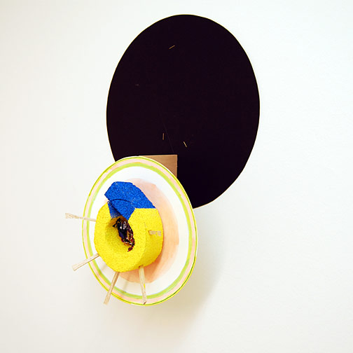 Richard Tuttle / Craft #8  2008 51.5 x 36 x 18 cm styrofoam, aluminium foile, bubble wrap, wood and acrylic paint mounted on painted cardboard circle on wood on black cardboard circle